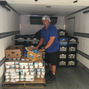 Aloha Harvest driver in temperature controlled truck, delivering food to Hawaii's hungry